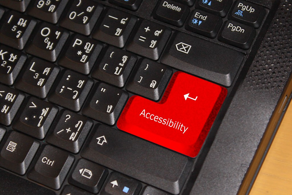 multilingual Black keyboard with red accessibility button