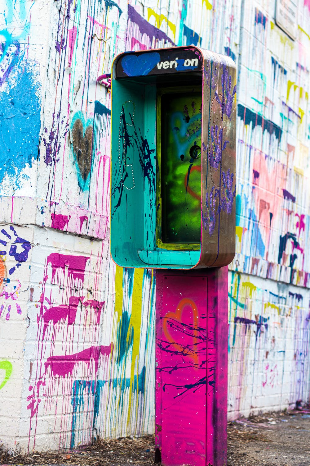 graffiti telephone booth with no phone