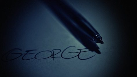 The name George handwritten on paper with pen